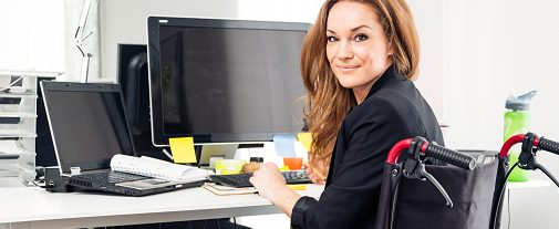 woman-sitting-in-wheelchair-working-in-modern-office-picture